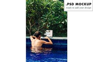 Freelance traveler working at pool
