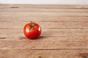 One ripe tomato on a decorative boar