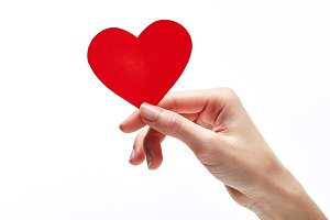 Red heart in woman hand isolated on