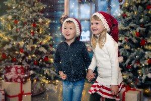 Happy children beside Christmas tree