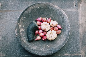 Onions And Garlic In Mortar