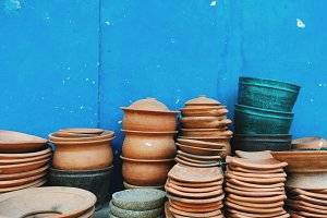 Clay Bowls Against Blue Wall