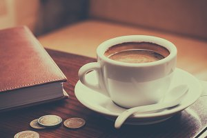 Coffee cup and diary