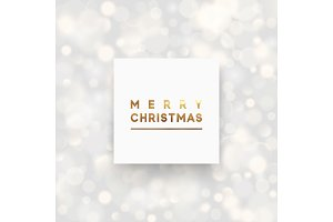 Merry Christmas greeting card, banner, poster, with a light bokeh background