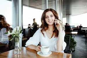 business lady speaks by smartphone