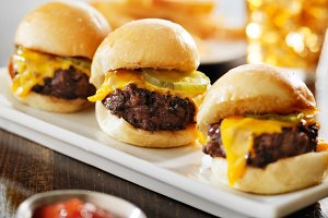 three mini hamburger sliders