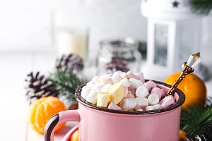 Red mug with hot chocolate with melted marshmallow