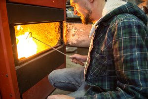 People working in the boiler on solid fuel