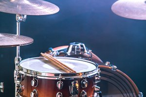 musical instruments drum kit, flash of light, a beautiful light in the background with copy space