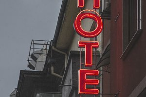 Small cheap hotel. Text Hotel on fac