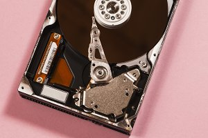 Open hard disc on pink