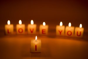 I Love You words on candle.
