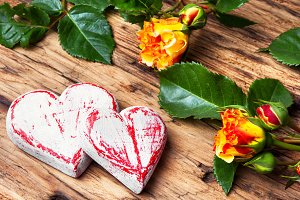 Symbolic wooden heart and flowers