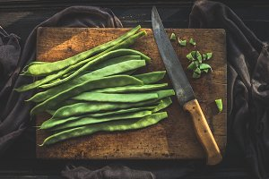 Green french beans on cutting board