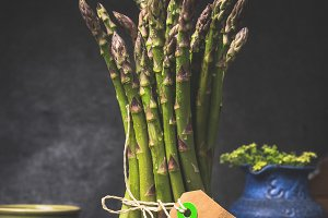 Green asparagus bunch with blank tag