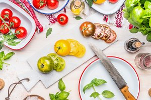 Colorful sliced tomatoes with knife
