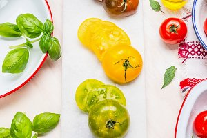 Green,yellow and red tomatoes salad