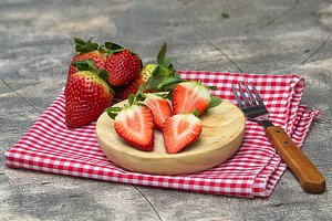 Group of strawberries on wooden plat