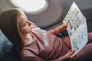 Girl is reading insructions in arplane