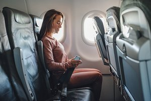 Girl is strapped on the plane