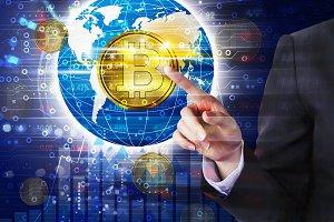 Business woman hand touching bitcoin