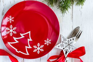 Christmas table setting with christmas decorations  on white background