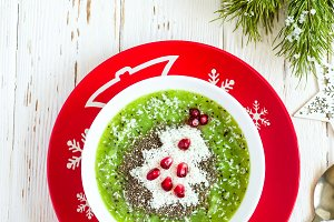 Christmas food healthy idea. Green smoothies decorated with Christmas tree