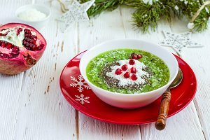 Christmas food healthy idea. Green smoothies decorated with Chri