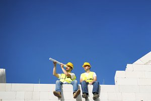 Two builders working.