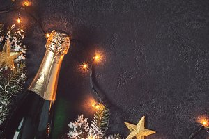 Christmas background with champagne and luminous garland