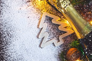 Christmas card background with Christmas fir and champagne
