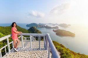 Woman tourist on peak viewpoint of island