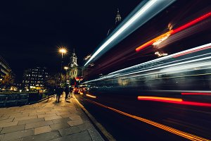 Red London bus at night
