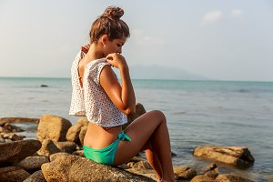 Pretty young girl undress on beach