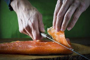 Slicing gravlax salmon with a knife
