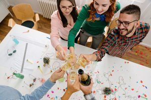 Happy coworkers toasting at office party