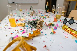 Confetti and champagne all over conference room table