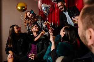 Group of people toasting to a New Year at a party
