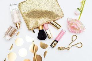 Cosmetics gold color. Flat lay