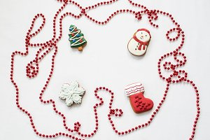 Gingerbread cookies hanging over white background