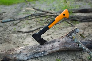 the axe in the tree. Tourist camp