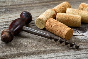Old corkscrew with used corks