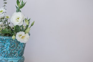 Whilte lisianthus in turquoise vase
