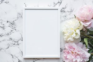 White frame mock up and flowers