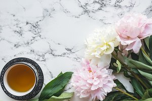 Peonies and cup of tea
