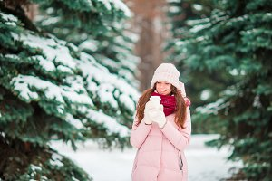 Happy girl enjoy winter and snow weather outdoors on beautiful wonter day