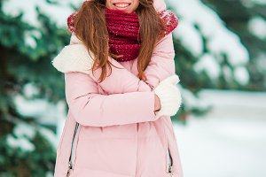 Happy girl enjoy winter and snow weather outdoors on beautiful winter day