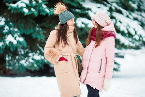 Young women outdoors on beautiful winter snow day