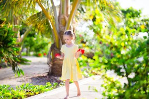 Adorable little girl during beach vacation in luxury resort