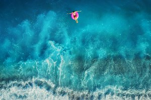 Aerial view of woman at the sea